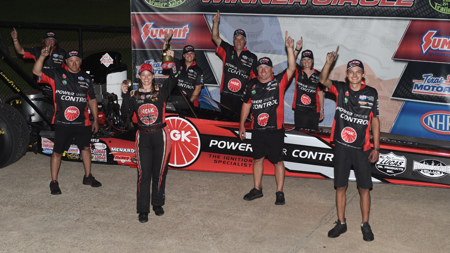 Top Alcohol Dragster pilot Megan Meyer hoisting the Wally after winning the Keurig Dr. Pepper Lone Star Nationals presented by Driven Automotive Protection