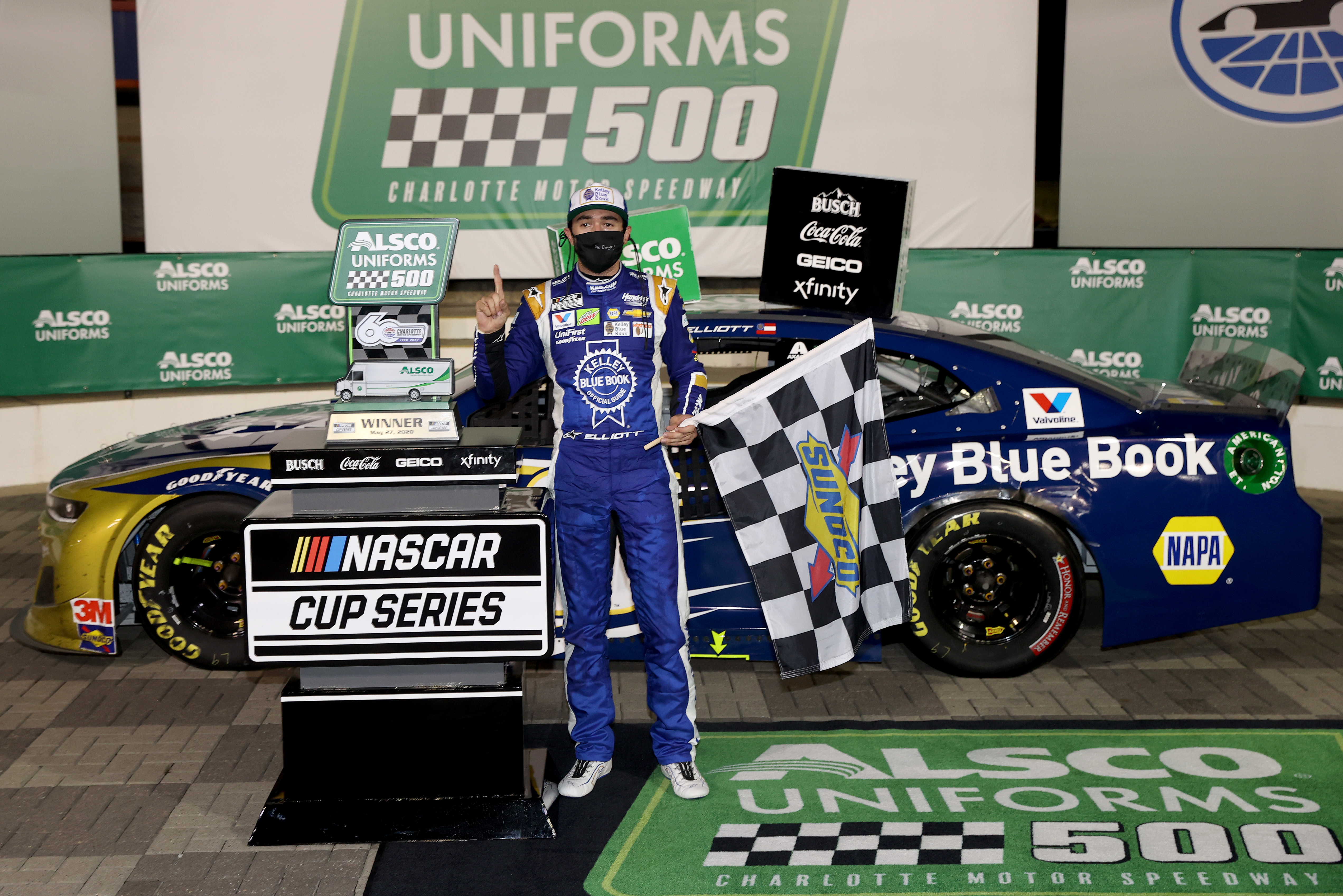 NASCAR Cup Series driver Chase Elliott celebrates in Victory Lane after winning the NASCAR Cup Series Alsco Uniforms 500