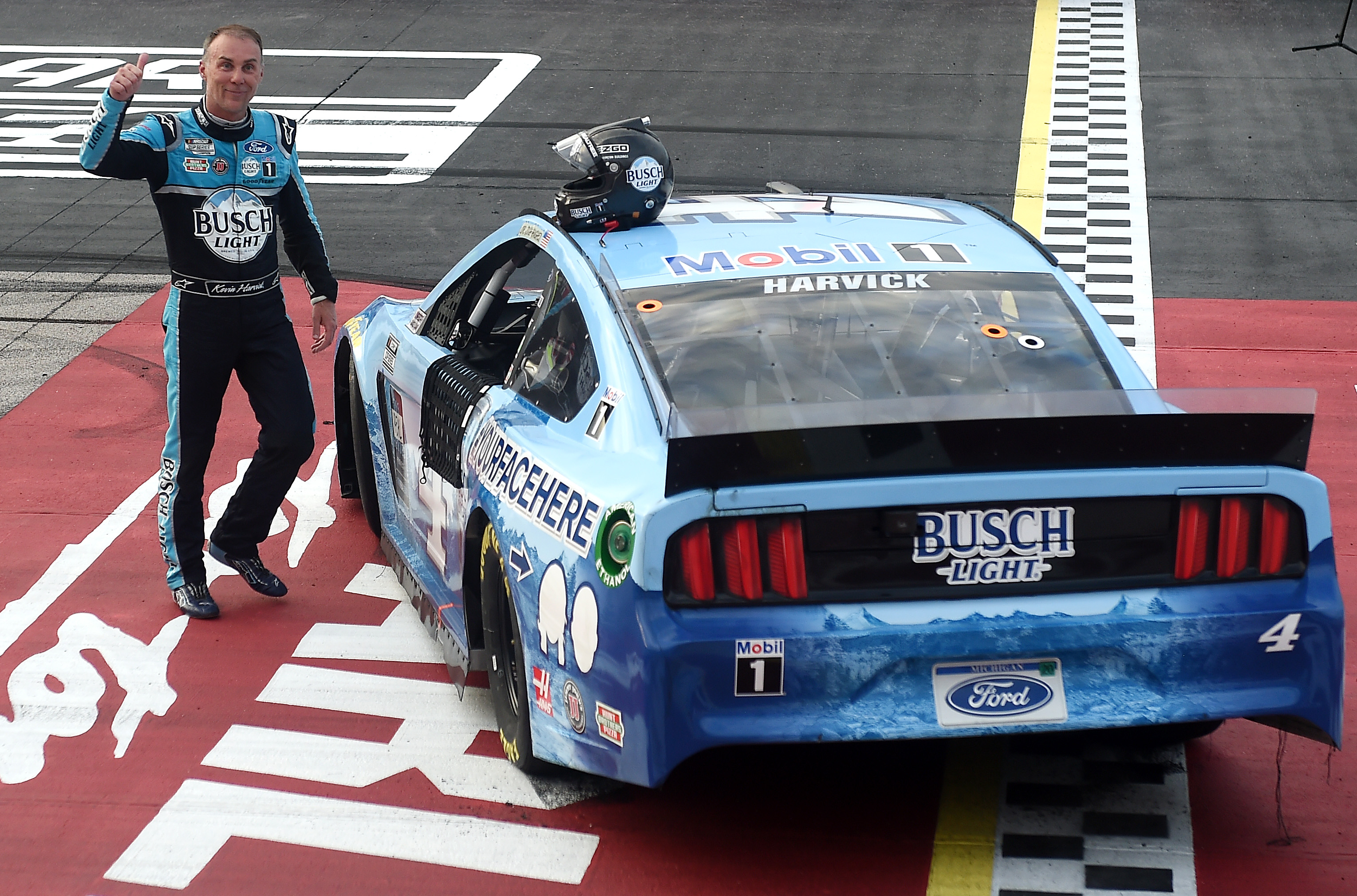 NASCAR Cup Series driver Kevin Harvick celebrates after winning The Real Heroes 400