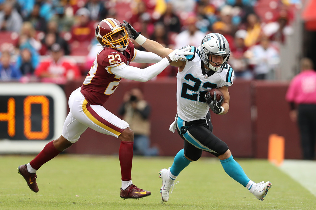 Former Washington Redskins cornerback Quinton Dunbar attempting to tackle Christian McCaffrey against the Carolina Panthers