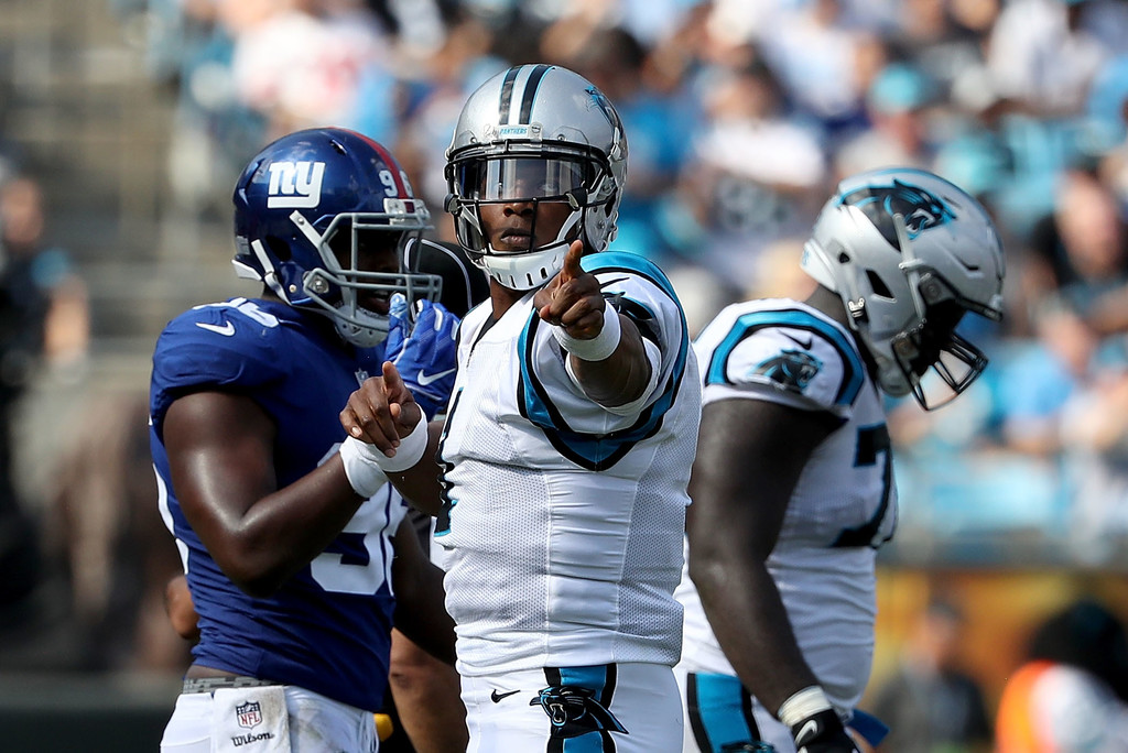 Former Carolina Panthers quarterback Cam Newton indicates a first down following a play against the New York Giants