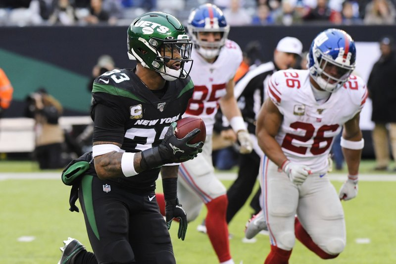 New York Jets strong safety Jamal Adams runs past Saquon Barkley against the New York Giants for a touchdown