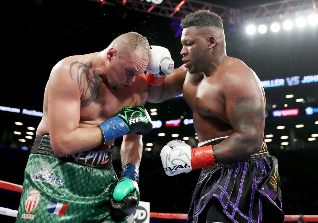 Heavyweight boxer Jarrell Miller exchanging punches with Johann Duhaupas