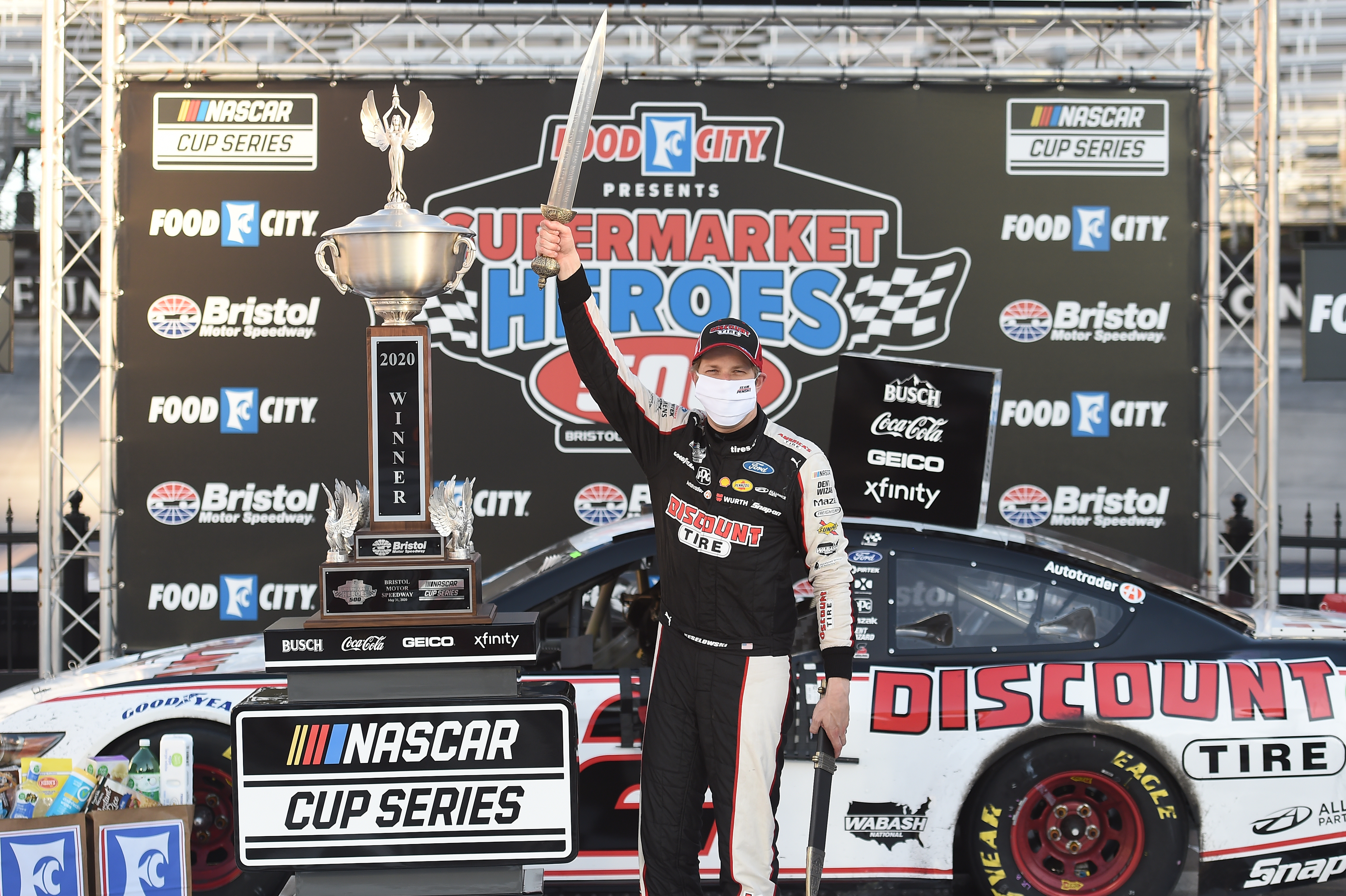 NASCAR Cup Series driver Brad Keselowski celebrates in Victory Lane after winning the NASCAR Cup Series Food City presents the Supermarket Heroes 500
