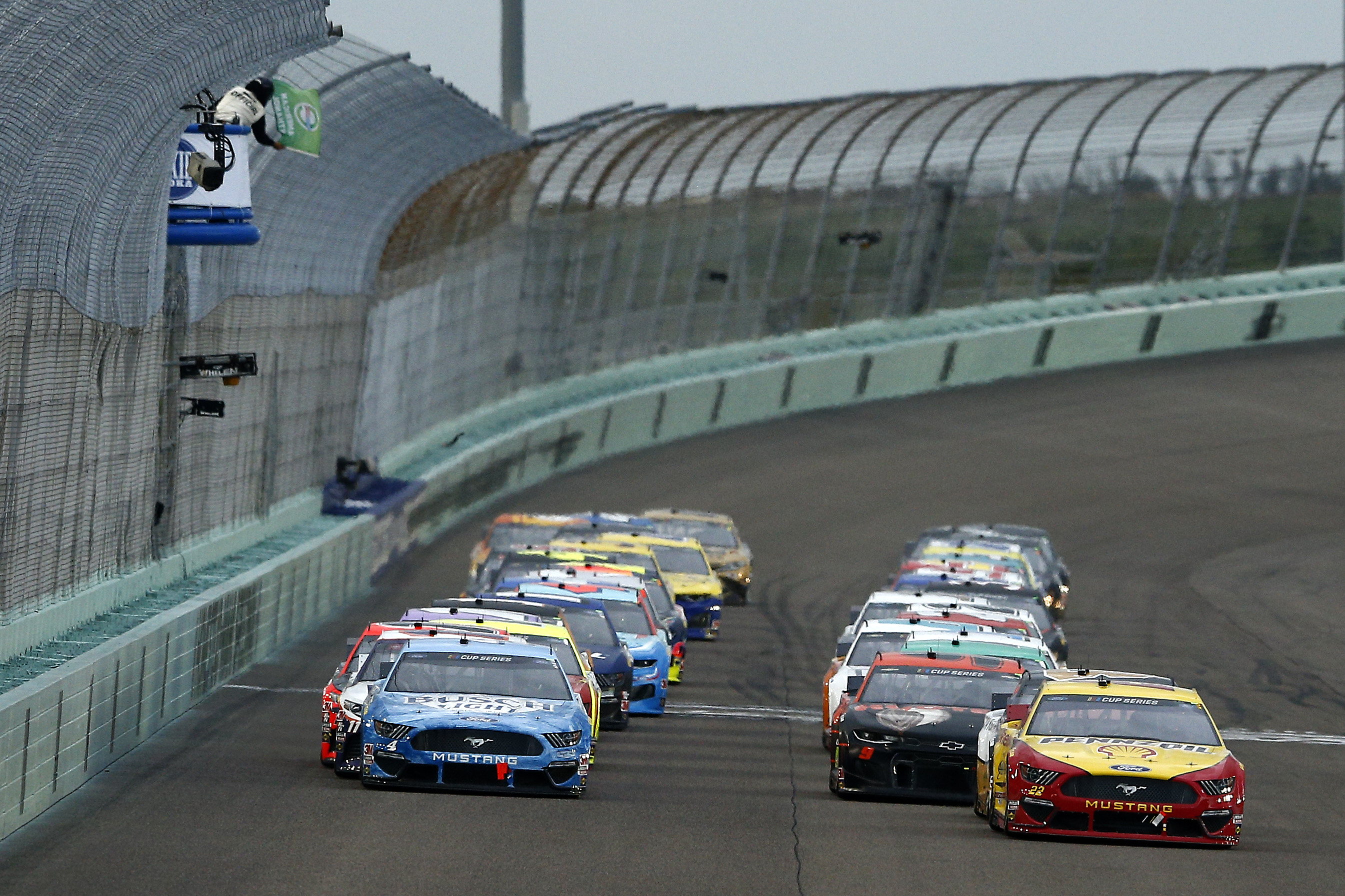 NASCAR drivers Joey Logano and Kevin Harvick lead the restart during the NASCAR Cup Series Dixie Vodka 400
