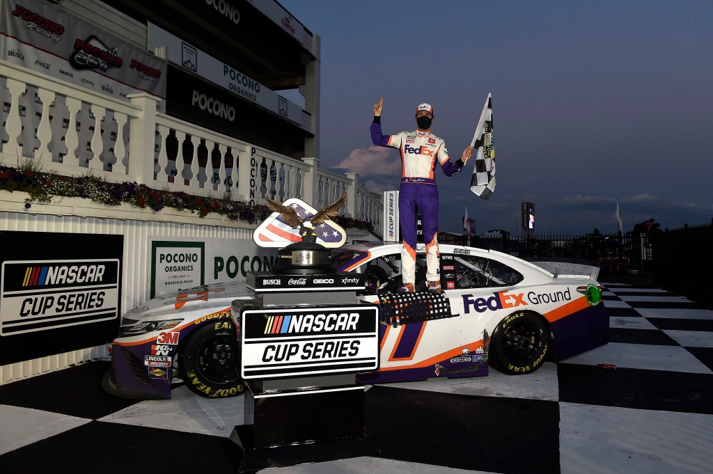 FedEx Ground Toyota driver Denny Hamlin celebrates in victory lane after winning the NASCAR Cup Series Pocono 350