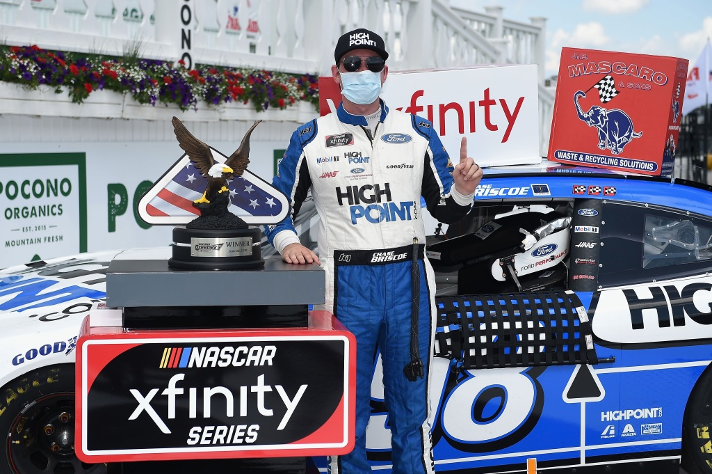 Highpoint.com Ford driver Chase Briscoe celebrates in Victory Lane after winning the NASCAR Xfinity Series Pocono Green 225