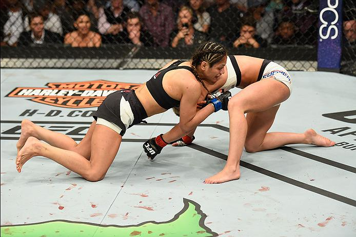 UFC fighter Cynthia Calvillo attempts to submit Amanda Cooper in their women's strawweight bout during the UFC 209 event