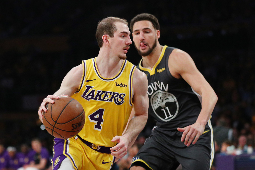 Los Angeles Lakers guard Alex Caruso is being defended by Klay Thompson against the Golden State Warriors