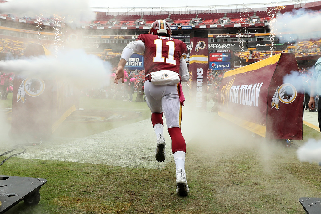 Washington Football Team quarterback Alex Smith is introduced before a game against the Carolina Panthers