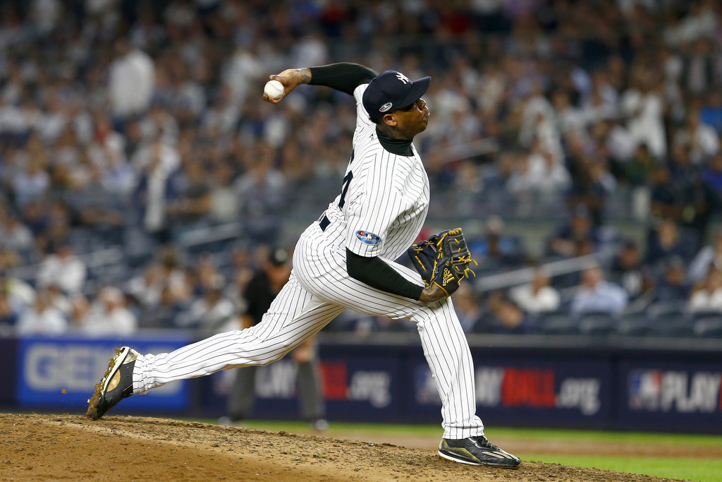 New York Yankees pitcher Aroldis Chapman throws a pitch against the Boston Red Sox in the 2018 MLB Playoffs