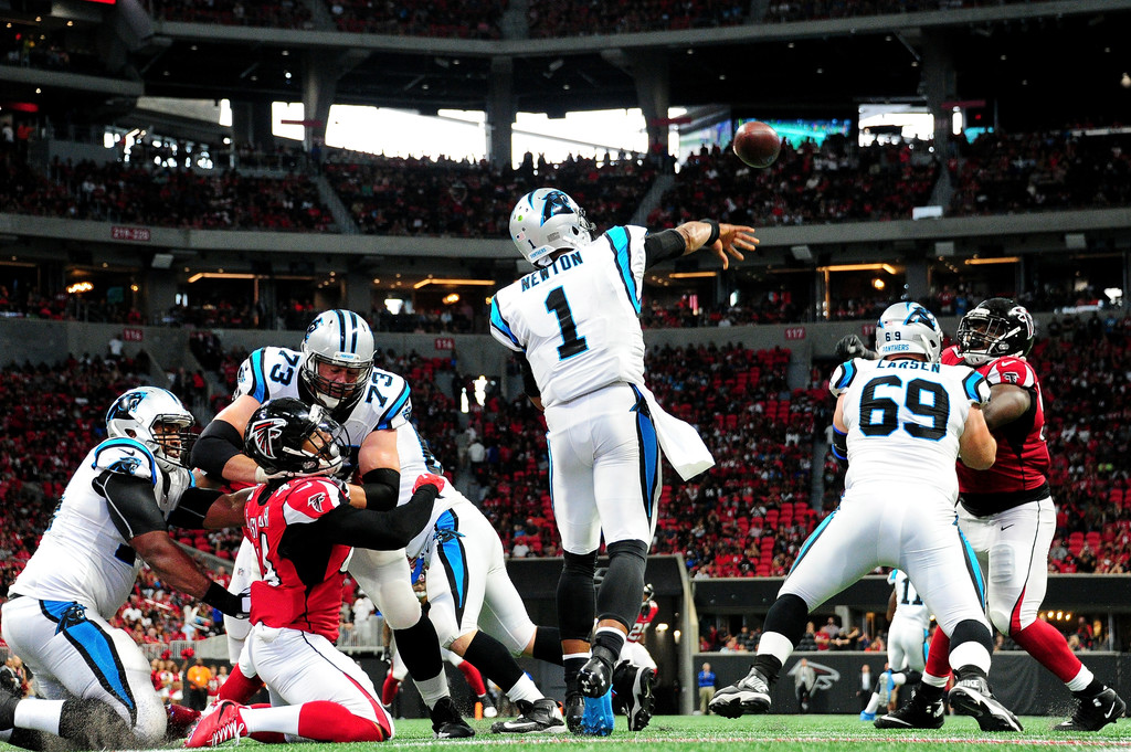 Former Carolina Panthers quarterback Cam Newton attempting a pass against the Atlanta Falcons