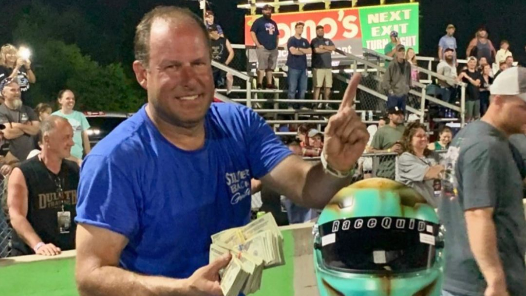 Memphis Street Outlaws drag racer Dennis Bailey celebrates his win at Crossville Dragway