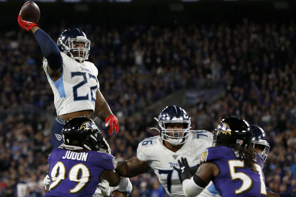 Tennessee Titans running back Derrick Henry attempts a jump pass for a touchdown to Corey Davis against the Baltimore Ravens in the AFC Divisional Playoff Game