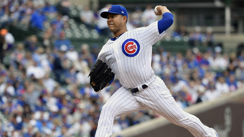 Chicago Cubs pitcher Jose Quintana delivers a pitch against the Cincinnati Reds