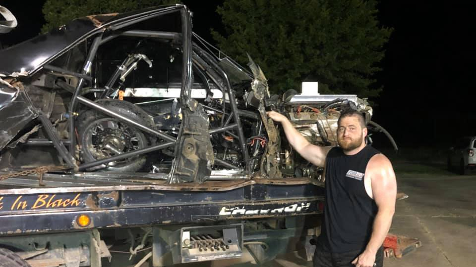 """Chris """"Kamikaze Chris"""" Day stands next to the Elco that he crashed during the taping of 2020 Street Outlaws season."""