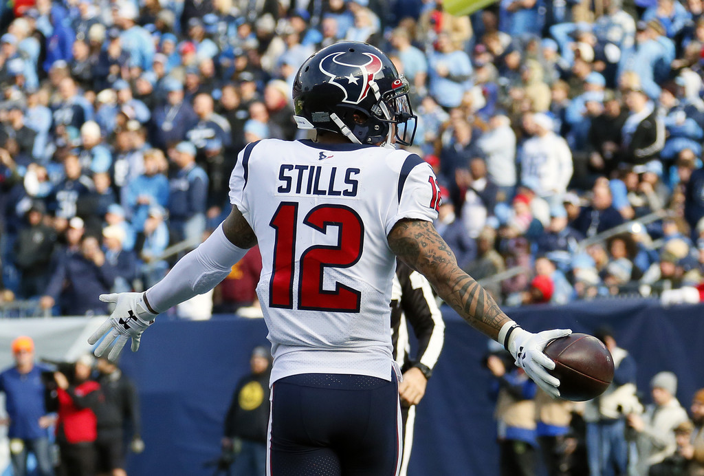 Houston Texans wide receiver Kenny Stills taunts the crowd after scoring a touchdown against the Tennessee Titans