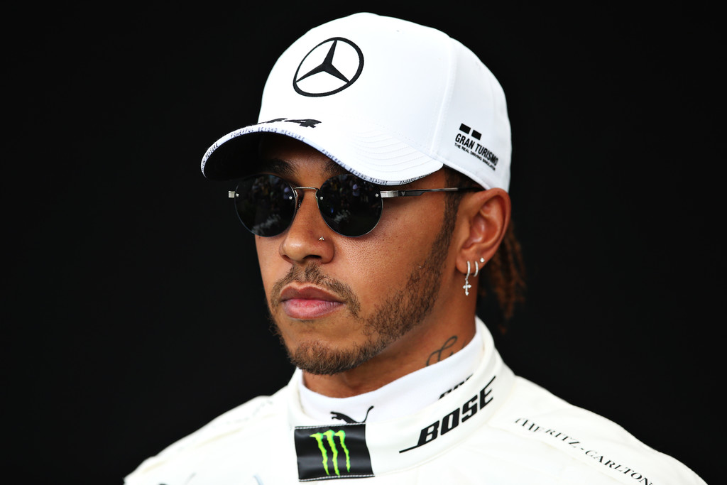 Formula One driver Lewis Hamilton poses for a photo in the Paddock during previews ahead of the F1 Grand Prix of Australia