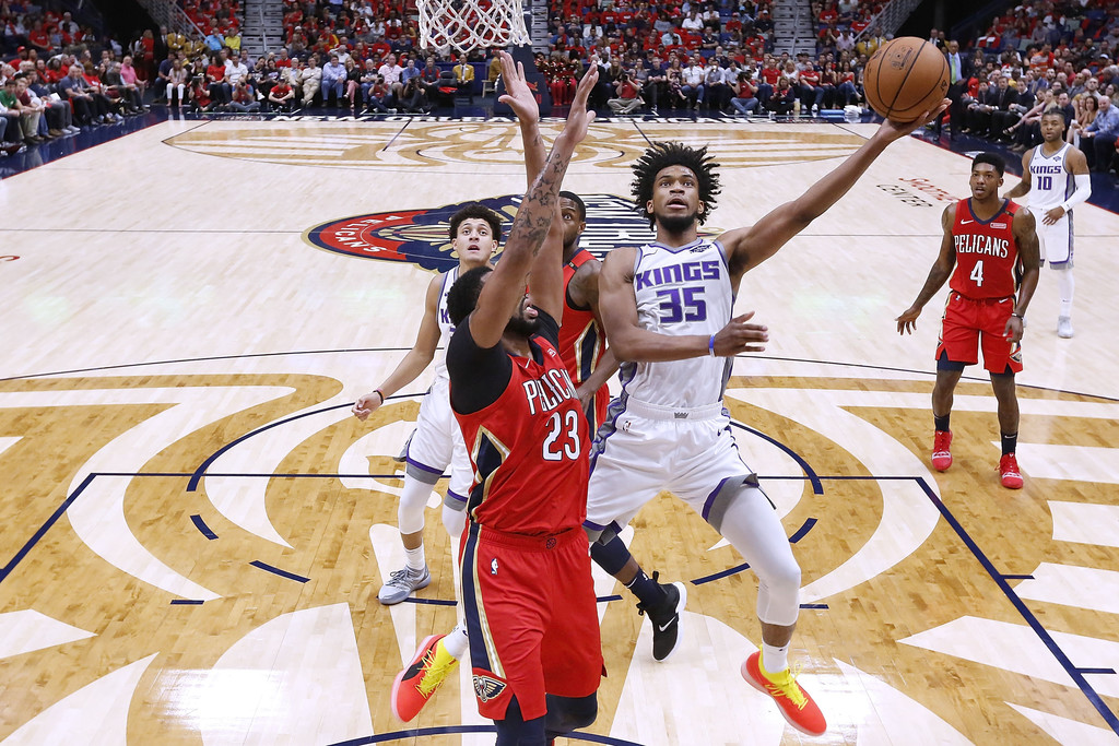 Sacramento Kings big man Marvin Bagley III shoots against Anthony Davis against the New Orleans Pelicans