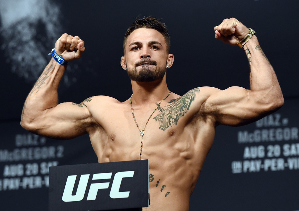 Mixed Martial Arts fighter Mike Perry poses on the scale during UFC 202 weigh-ins