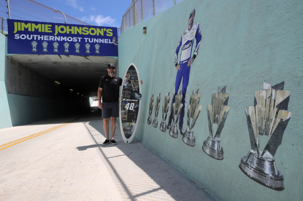 Ally Chevrolet driver Jimmie Johnson poses for a photo opportunity after having the turn three tunnel named in his honor prior to the NASCAR Cup Series Dixie Vodka 400