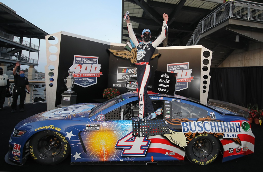 Busch Light Patriotic Ford driver Kevin Harvick celebrates in Victory Lane after winning the NASCAR Cup Series Big Machine Hand Sanitizer 400 Powered by Big Machine Records