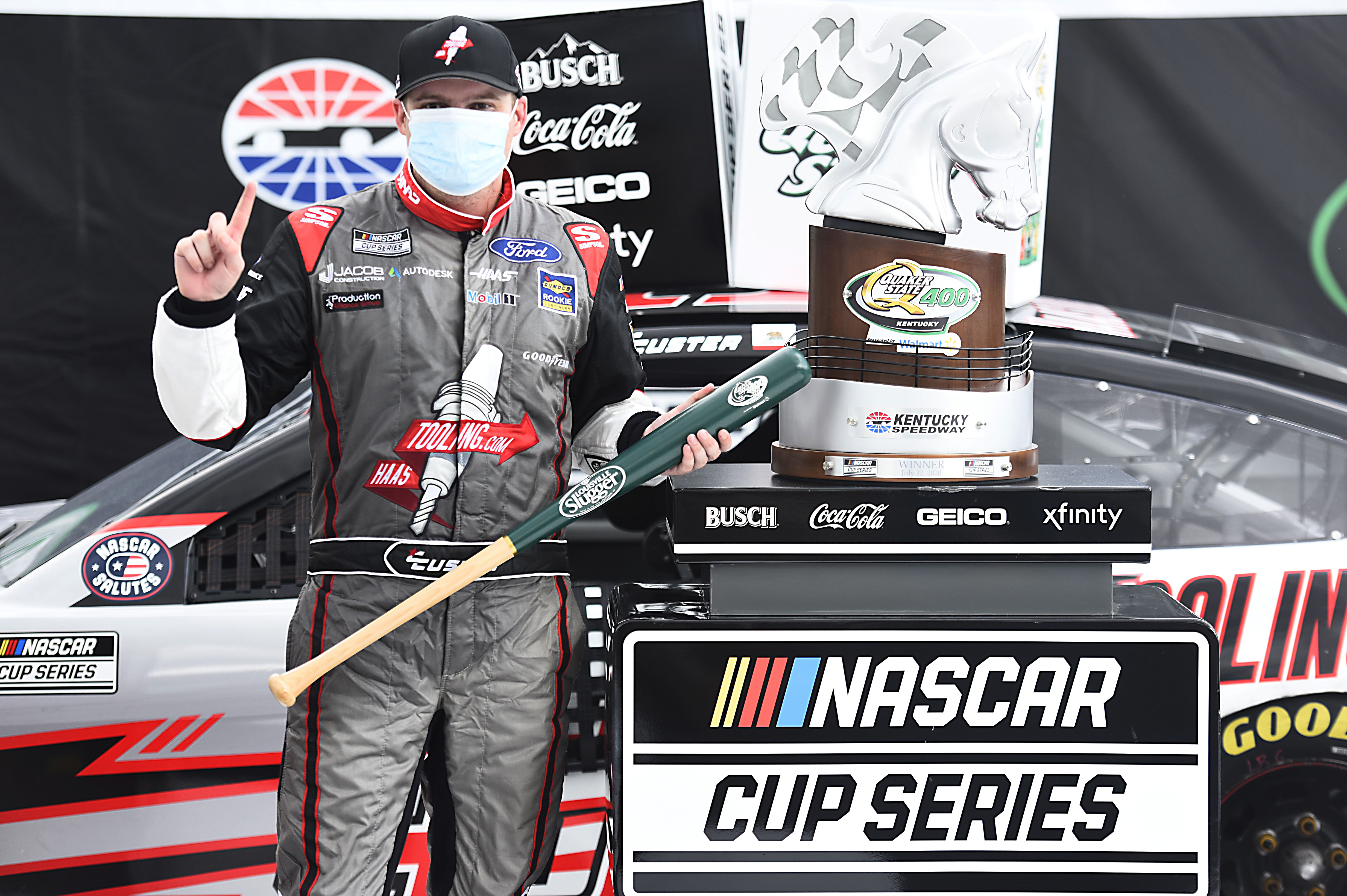 HaasTooling.com Ford driver Cole Custer celebrates in Victory Lane after winning the NASCAR Cup Series Quaker State 400 Presented by Walmart