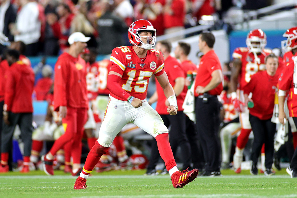 Kansas City Chiefs quarterback Patrick Mahomes III celebrates after throwing a touchdown pass against the San Francisco 49ers in Super Bowl LIV