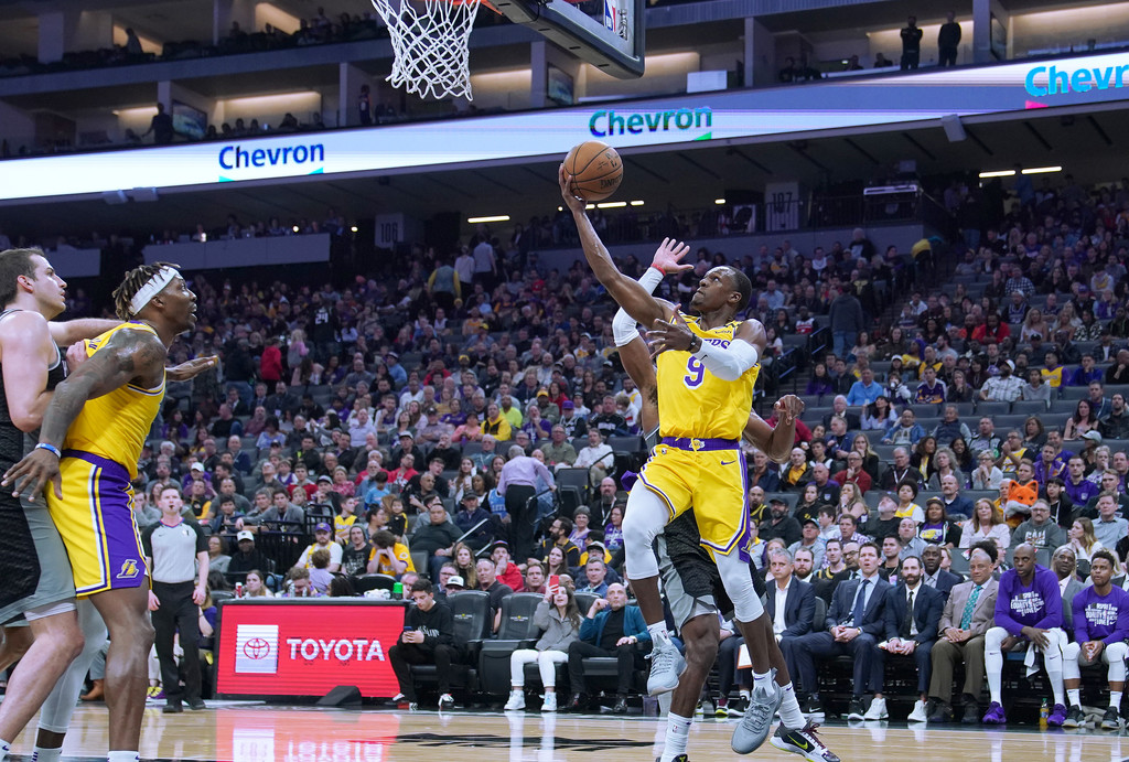 Los Angeles Lakers point guard Rajon Rondo goes in for a layup against the Sacramento Kings