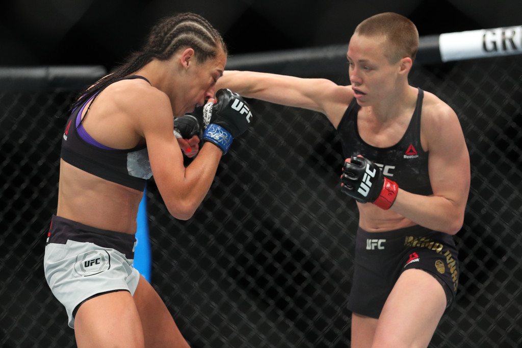 Rose Namajunas throws a right hand at Joanna Jędrzejczyk during their UFC Women's Strawweight Championship bout at UFC 223
