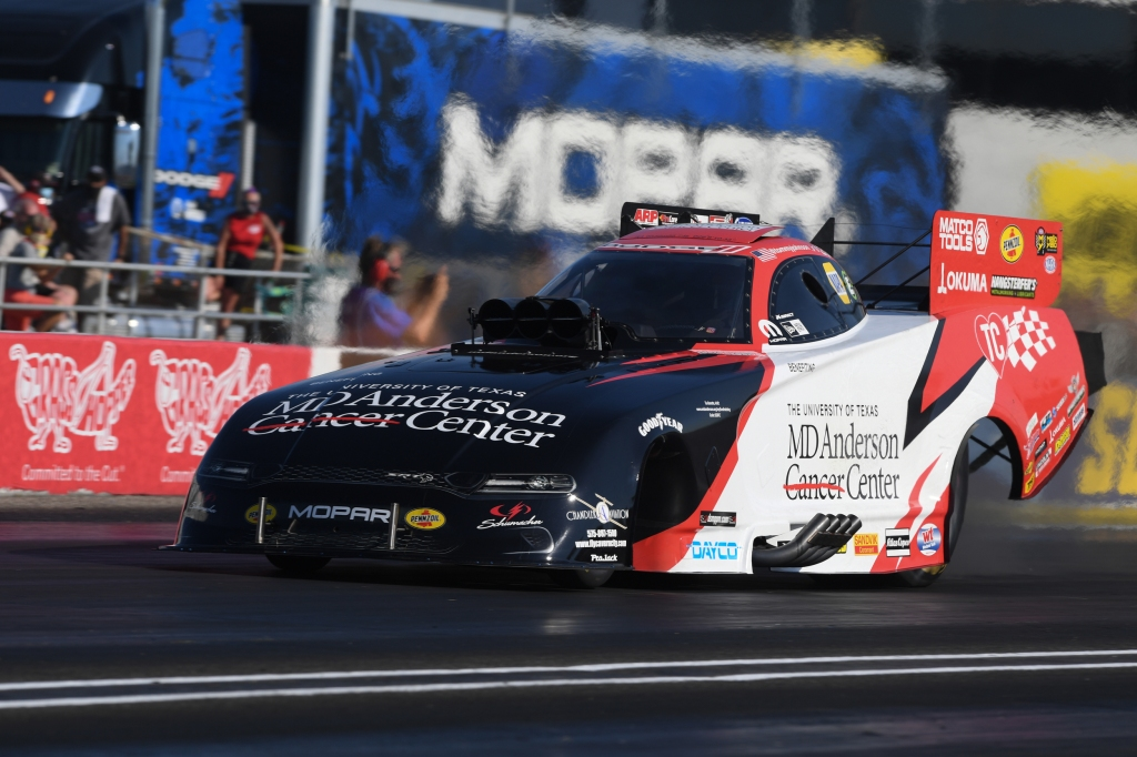 MD Anderson Cancer Center Funny Car pilot Tommy Johnson Jr. racing on Saturday at the Dodge NHRA Indy Nationals presented by Pennzoil