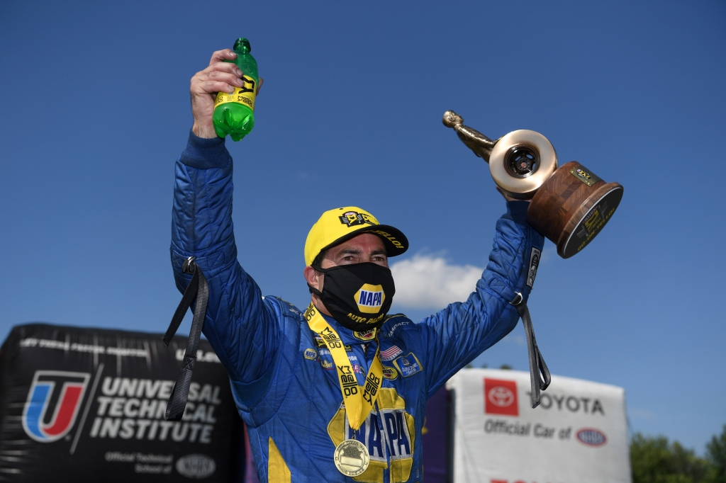 NAPA Auto Parts Funny Car pilot Ron Capps celebrates with the Wally after winning the Dodge NHRA Indy Nationals presented by Pennzoil
