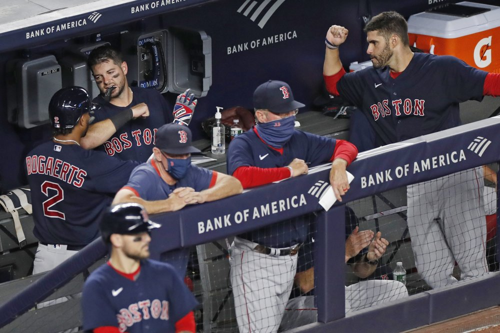 Boston Red Sox player Xander Bogaerts celebrates with his teammates in the dugout after hitting a home run against the New York Yankees