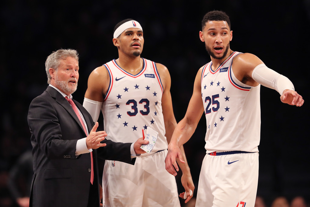 Former Philadelphia 76ers head coach Brett Brown talks to Tobias Harris and Ben Simmons during a game against the Brooklyn Nets during the First Round of the 2019 NBA Playoffs