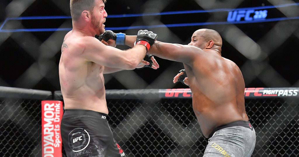 Former heavyweight champion Daniel Cormier throws a punch against Stipe Miocic at UFC 226