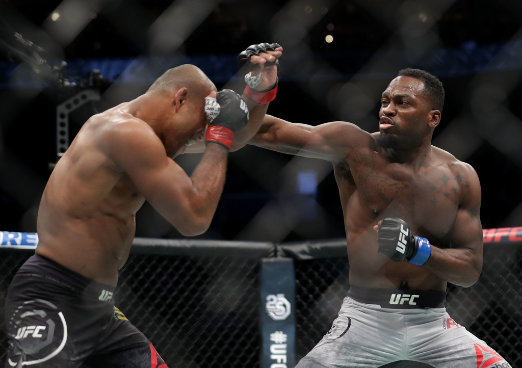 "UFC fighter Derek Brunson punching Ronaldo ""Jacare"" Souza in their middleweight bout at UFC Fight Night"