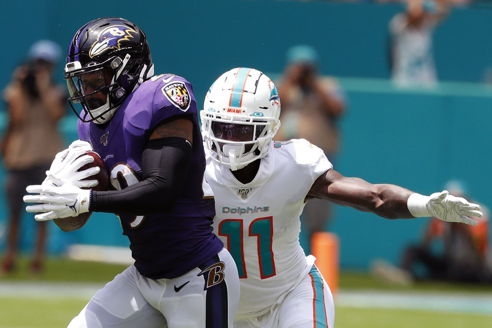 Baltimore Ravens safety Earl Thomas intercepts a pass that was intended for DeVante Parker against the Miami Dolphins
