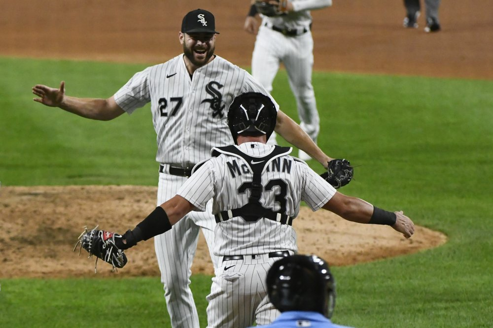 Chicago White Sox starting pitcher Lucas Giolito celebrates with catcher James McCann after closing out a no-hitter against the Pittsburgh Pirates