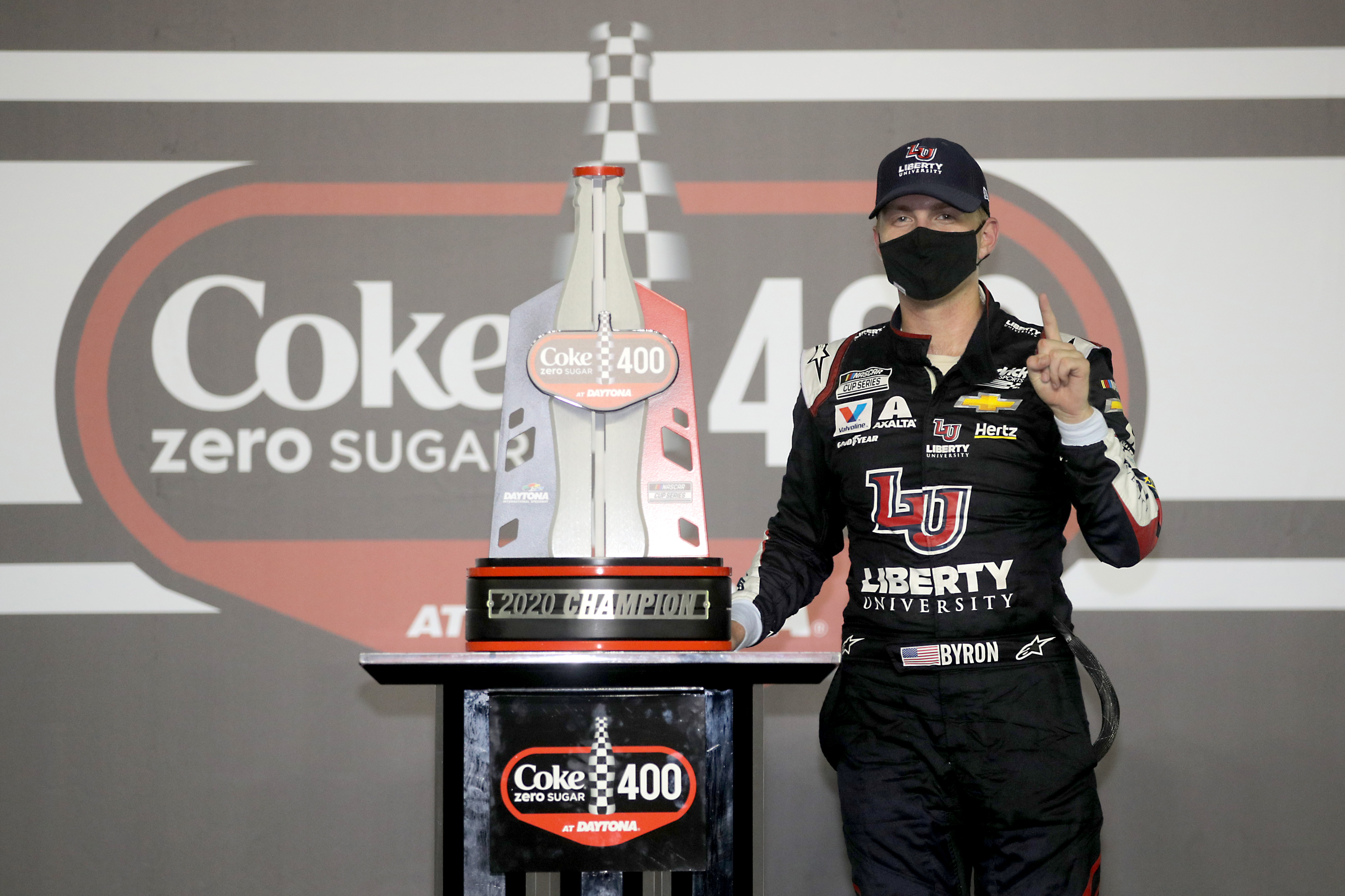 Liberty University Chevrolet driver William Byron celebrates in Victory Lane after winning the NASCAR Cup Series Coke Zero Sugar 400
