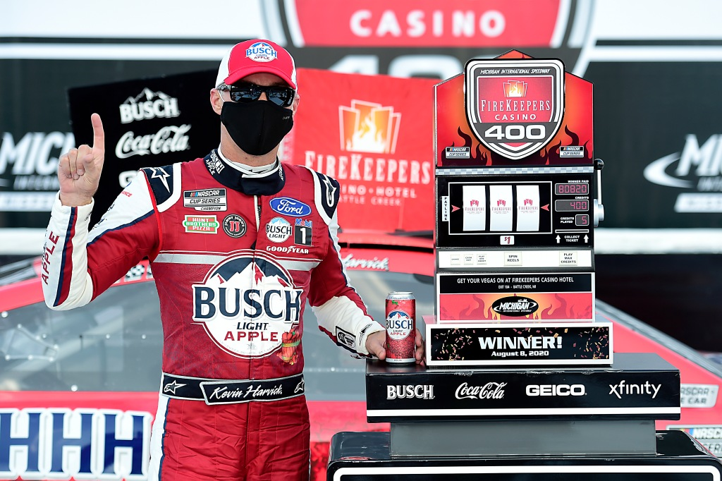 Busch Light Apple Ford driver Kevin Harvick celebrates in Victory Lane after winning the NASCAR Cup Series FireKeepers Casino 400