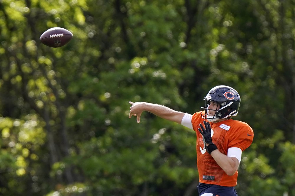 Chicago Bears quarterback Nick Foles attempts a pass during practice