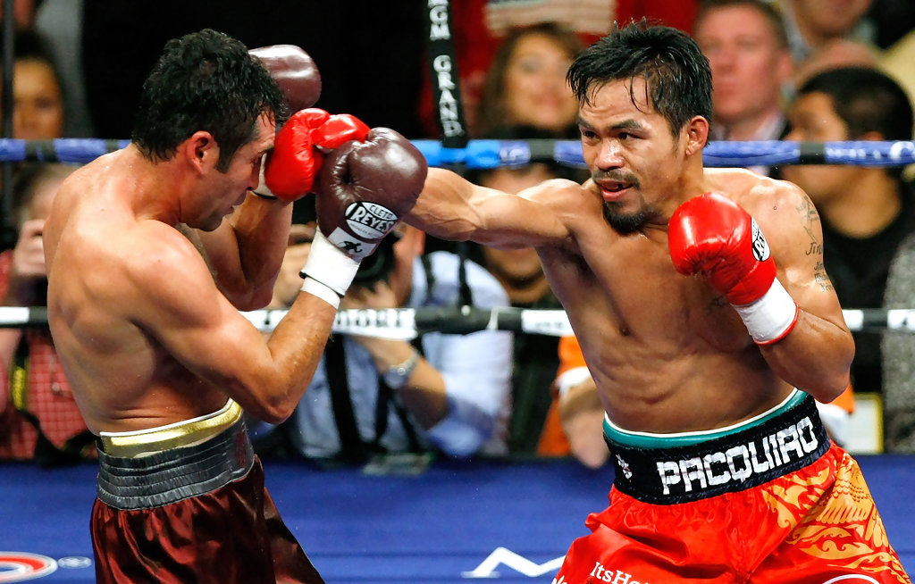 Boxer Manny Pacquiao punches Oscar De La Hoya in the fifth round of their welterweight bout