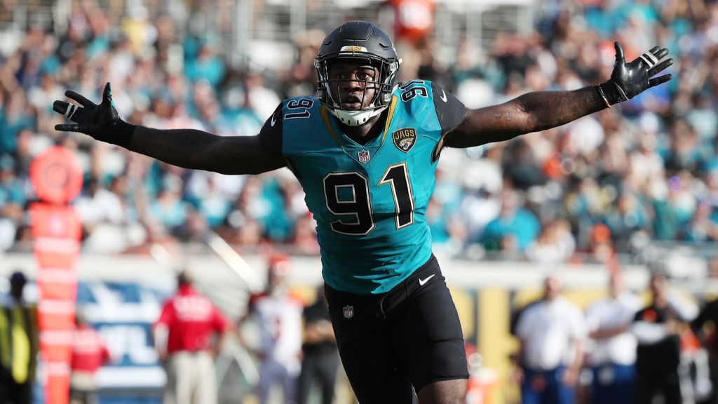 Former Jacksonville Jaguars defensive end Yannick Ngakoue celebrates a play on the field against the Cincinnati Bengals