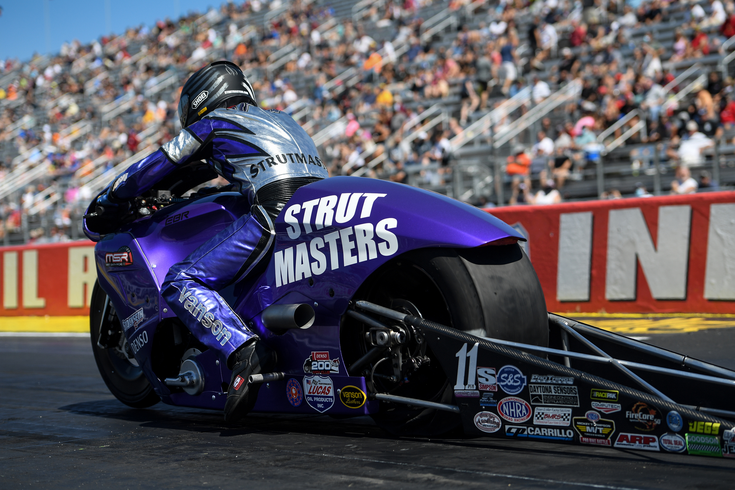 Strutmasters.com Pro Stock Motorcycle rider Scotty Pollacheck racing on Saturday at the Denso Spark Plugs NHRA U.S. Nationals