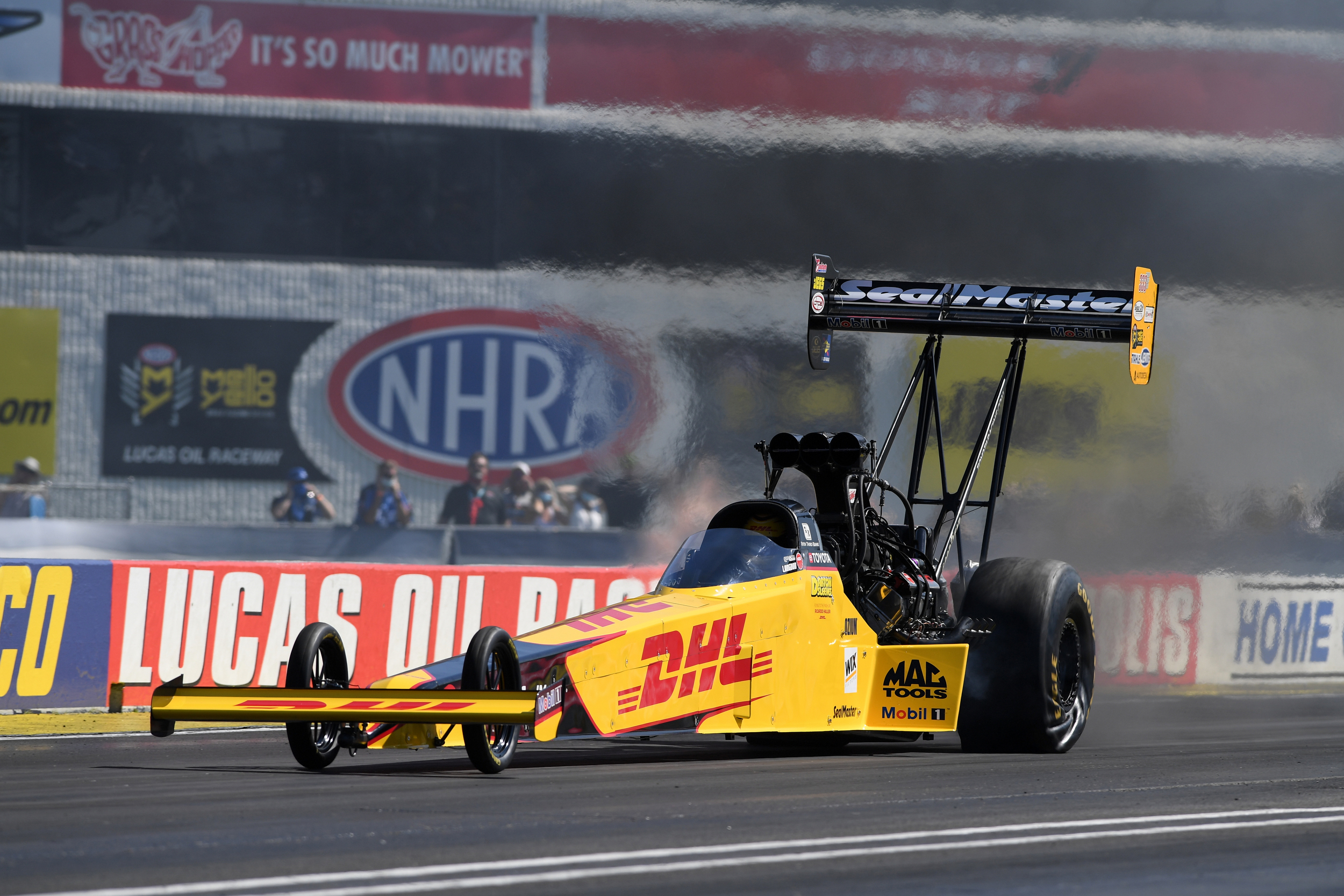 DHL Top Fuel Dragster pilot Shawn Langdon racing on Saturday at the Denso Spark Plugs U.S. Nationals