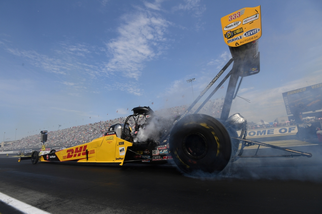 DHL Top Fuel Dragster pilot Shawn Langdon racing on Sunday at the prestigious Denso Spark Plugs U.S. Nationals