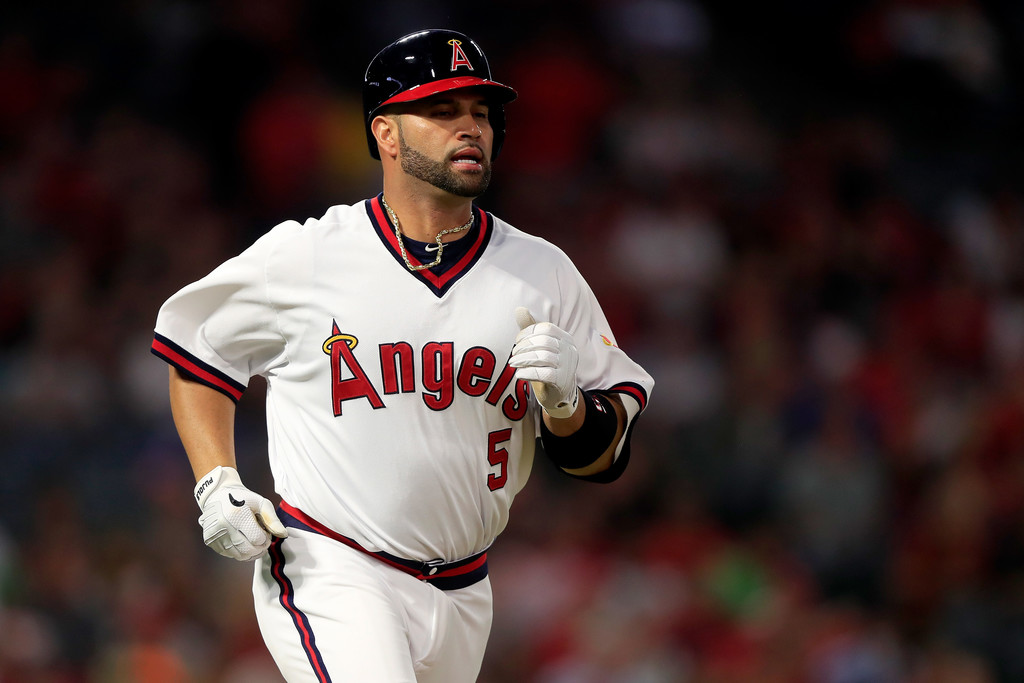 Los Angeles Angels slugger Albert Pujols looks on after flying out against the Colorado Rockies
