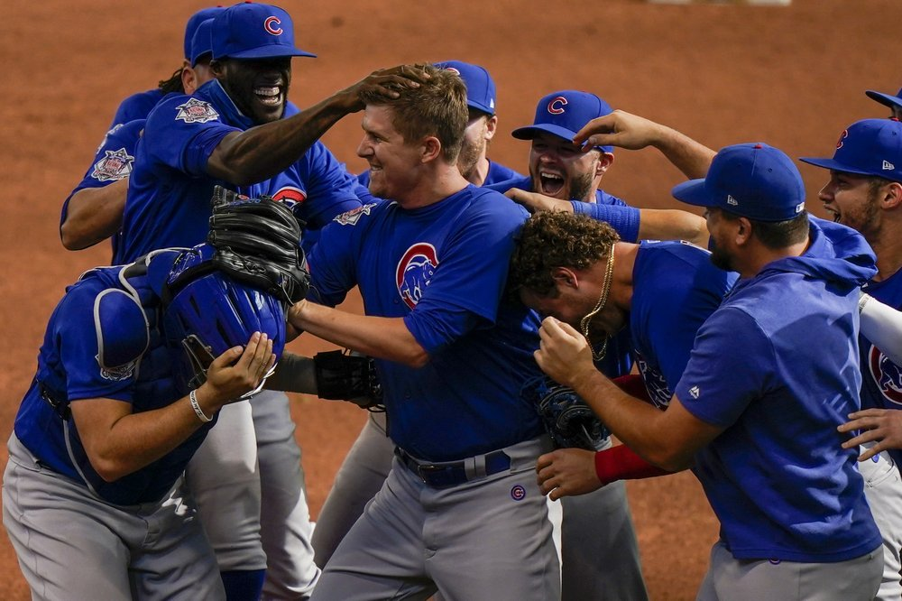 Chicago Cubs pitcher Alec Mills is swarmed by his teammates after throwing a no-hitter against the Milwaukee Brewers