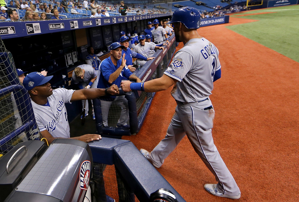 Kansas City Royals outfielder Alex Gordon is congratulated after scoring a run in the first inning during a game against the Tampa Bay Rays