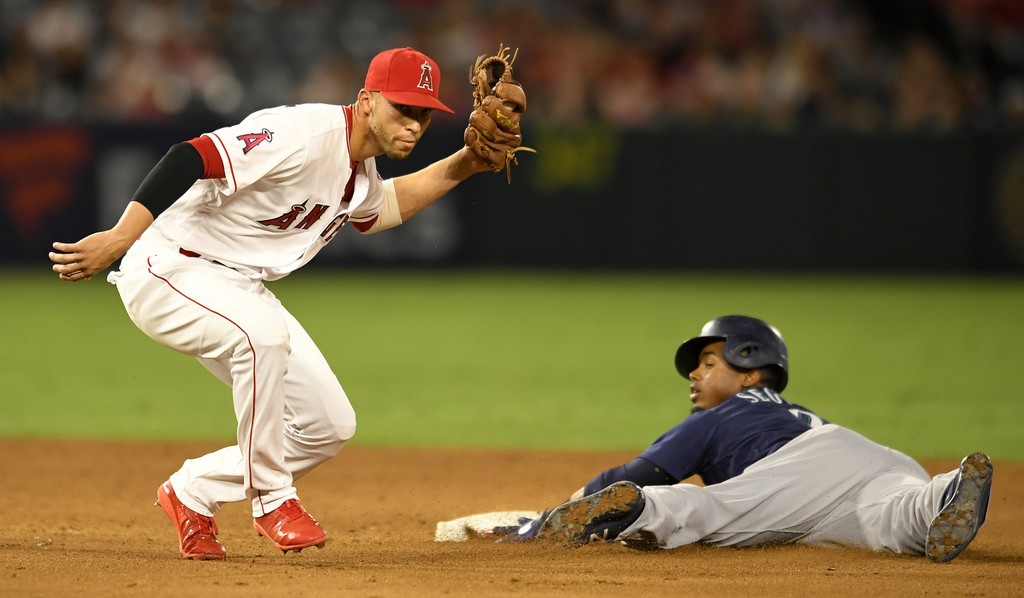 Los Angeles Angels shortstop Andrelton Simmons tags out Seattle Mariners infielder Jean Segura, as he was trying to steal second base